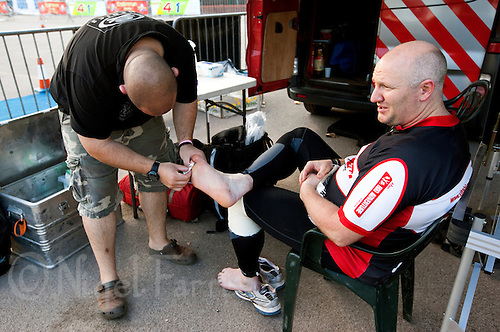 09 AUG 2010 - LICHFIELD, GBR - Justin Woodward receives treatment on his feet during the Triple Iron race at the Enduroman Ultra Triathlon Championships (PHOTO (C) NIGEL FARROW)