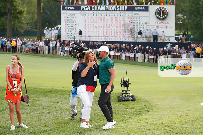 Brooks Koepka (USA) is congratulated by his mom and girlfriend Jena Sims on the 18th hole after winning the 100th PGA Championship at Bellerive Country Club, St. Louis, Missouri, USA. 8/12/2018.<br /> Picture: Golffile.ie | Brian Spurlock<br /> <br /> All photo usage must carry mandatory copyright credit (© Golffile | Brian Spurlock)