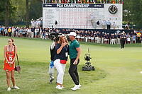 Brooks Koepka (USA) is congratulated by his mom and girlfriend Jena Sims on the 18th hole after winning the 100th PGA Championship at Bellerive Country Club, St. Louis, Missouri, USA. 8/12/2018.<br /> Picture: Golffile.ie | Brian Spurlock<br /> <br /> All photo usage must carry mandatory copyright credit (&copy; Golffile | Brian Spurlock)