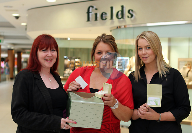 Michelle Farrelly and Stephanie Cullen from Fields Jewellers in the Laurence Centre as Centre Manager Susan Drumm picks out the winner of their competition...(Photo credit should read Jenny Matthews/NEWSFILE)...