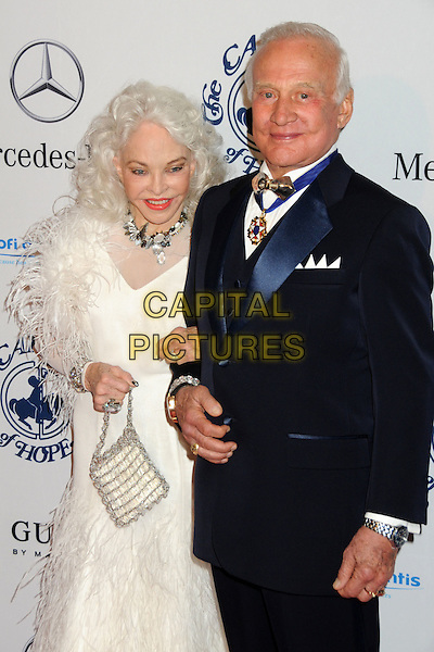 LOIS & BUZZ ALDRIN .32nd Anniversay Carousel of Hope Gala held at the Beverly Hilton Hotel, Beverly Hills, California, USA, .23rd October 2010..half length white dress black suit medal bag handbag feather feathers .CAP/ADM/BP.©Byron Purvis/AdMedia/Capital Pictures.