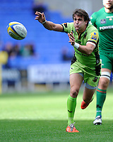 Lee Dickson of Northampton Saints passes during the Premiership Rugby match between London Irish and Northampton Saints at the Madejski Stadium on Saturday 4th October 2014 (Photo by Rob Munro)
