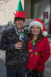 Tyler and Marie during the Ugly Sweater Wine Walk in downtown  Reno on Saturday, Dec. 16, 2017.