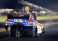 Oct 16, 2015; Ennis, TX, USA; A picture of presidential candidate Donald Trump on the roof escape hatch on the funny car of NHRA driver Cory Lee during qualifying for the Fall Nationals at the Texas Motorplex. Mandatory Credit: Mark J. Rebilas-USA TODAY Sports