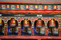 Colourful prayer wheels at the Kyichu Buddhist Temple in Paro, Bhutan.