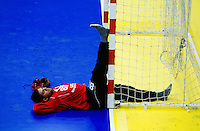 11 JUN 2010 - LONDON, GBR - Cypriot goalkeeper Christophoros Nungovitch stretches after the teams match against Bulgaria at their 2012 European Handball Championships Qualification Tournament .(PHOTO (C) NIGEL FARROW)
