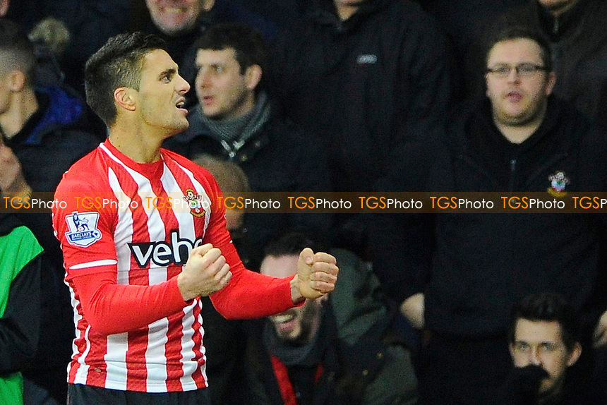 Dusan Tadic of Southampton celebrates after scoring the second goal - Southampton vs Arsenal - Barclays Premier League Football at St Mary's Stadium, Southampton, Hampshire - 01/01/15 - MANDATORY CREDIT: Denis Murphy/TGSPHOTO - Self billing applies where appropriate - contact@tgsphoto.co.uk - NO UNPAID USE