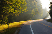 Morning sun along the Kancamagus Highway (route 112), which is one of New England's scenic byways in the White Mountains, New Hampshire USA