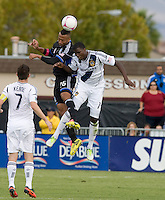 Edson Buddle of Galaxy fights for the ball against Victor Bernardez of Earthquakes during the game at Buck Shaw Stadium in Santa Clara, California on October 21st, 2012.  San Jose Earthquakes and Los Angeles Galaxy tied at 2-2.