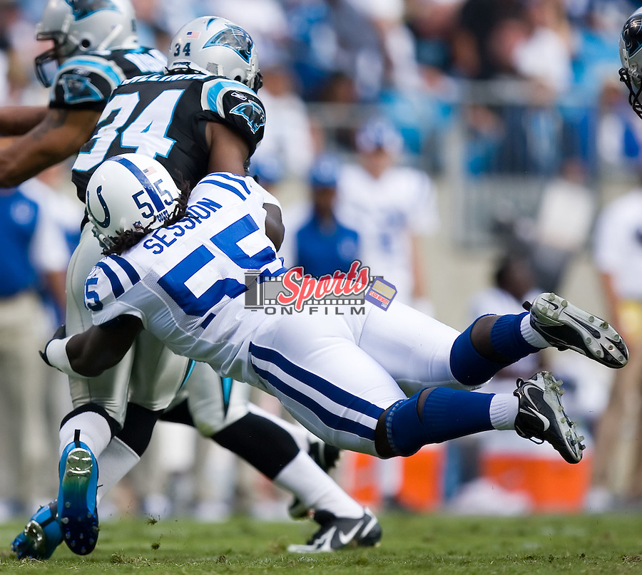 Indianapolis Colts linebacker Clint Session (55) tackles Carolina Panthers running back DeAngelo Williams (34) following a kick-off at Bank of America Stadium in Charlotte, NC, Sunday, October 28, 2007.