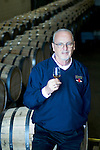 Jim Rutledge, the Master Distiller at Four Roses since 1995, takes in the aroma of a single barrel sample of Four Roses.