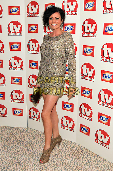 LUCY PARGETER .Attending the TV Choice Awards 2010 at The Dorchester, London, England, UK, September 6th, 2010..arrivals full length gold sequined sequin long sleeve mini dress brown ruched peep toe ankle boots heels .CAP/PL.©Phil Loftus/Capital Pictures.