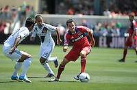 Chicago midfielder Marco Pappa (16) maneuvers away from LA Galaxy defender A.J. DeLaGarza (20, left) and midfielder Juninho (19).  The LA Galaxy defeated the Chicago Fire 2-0 at Toyota Park in Bridgeview, IL on July 8, 2012.