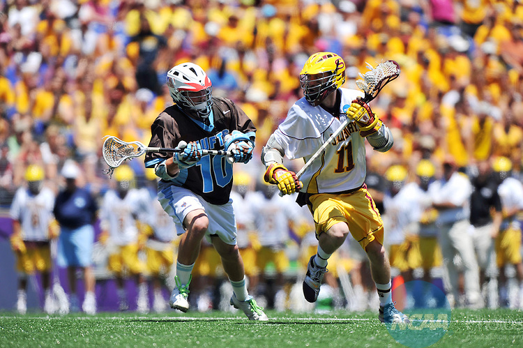 30 MAY 2010:  Shawn Zordani (11) of Salisbury University races past Kevin McCormick (10) of Tufts University during the Division III Men's Lacrosse Championship held at M+T Bank Stadium in Baltimore, MD. Tufts defeated Salisbury 9-6 for the national title. Larry French/NCAA Photos