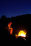 Man sitting in front of campfire, Grand Staircase-Escalante National Monument, Utah