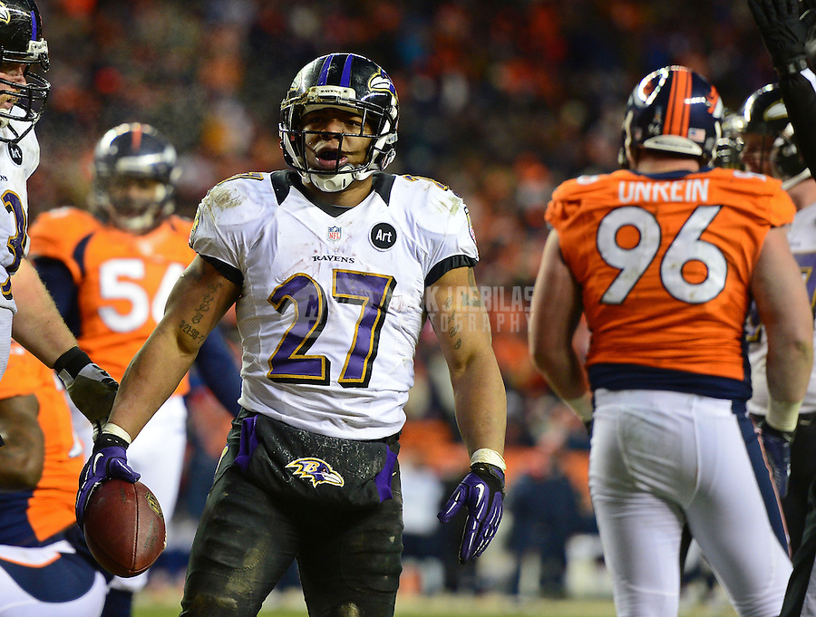 Jan 12, 2013; Denver, CO, USA; Baltimore Ravens running back Ray Rice (27) celebrates a touchdown against the Denver Broncos during the AFC divisional round playoff game at Sports Authority Field.  Mandatory Credit: Mark J. Rebilas-