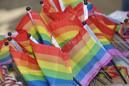 Raibow flags on sale at the Rainbow Pride parade in Shibuya, Tokyo on Sunday April 27, 2015. An estimated 3000 people paraded through the streets of Shibuya on Sunday celebrating a recent increase in recognition of LGTB rights in Japan. The event was organised across two days for the first time, and came after a move earlier this year where Shibuya Ward declared that people in same-sex partnerships should have many of the same rights as married couples. Major companies such as Google, Gap, Nomura also got involved in the celebrations. (Duits.co/AFLO)