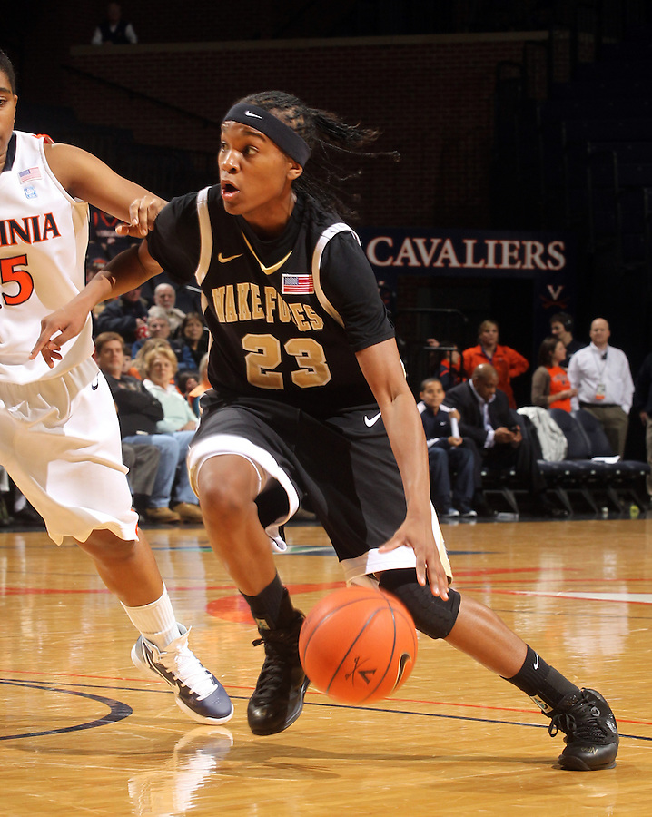 Feb. 3, 2011; Charlottesville, VA, USA; Wake Forest Demon Deacons guard Secily Ray (23) drives past Virginia Cavaliers forward/center Erinn Thompson (5) during the game at the John Paul Jones Arena.  Mandatory Credit: Andrew Shurtleff