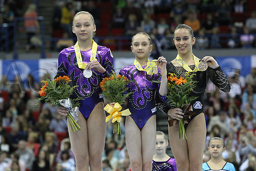 Vault podium with Erika Fasana of Italy in third place, right, Maria Paseka of Russia in second place, left, Victoria komova in first place, middle during the juniors women apparatus final at the European Artistic Gymnastics Championship at National Indoor Arena in Birmingham, UK on May 2, 2010