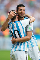 Lionel Messi of Argentina celebrates scoring a goal with Ezequiel Garay after making it 2-1
