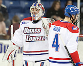Doug Carr (UML - 31), Joe Houk (UML - 4) - The University of Massachusetts Lowell River Hawks defeated the visiting American International College Yellow Jackets 6-1 on Tuesday, December 3, 2013, at Tsongas Arena in Lowell, Massachusetts.