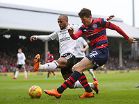 17th March 2018, Craven Cottage, London, England; EFL Championship football, Fulham versus Queens Park Rangers; Pawel Wszolek of Queens Park Rangers crossing the ball past Denis Odoi of Fulham