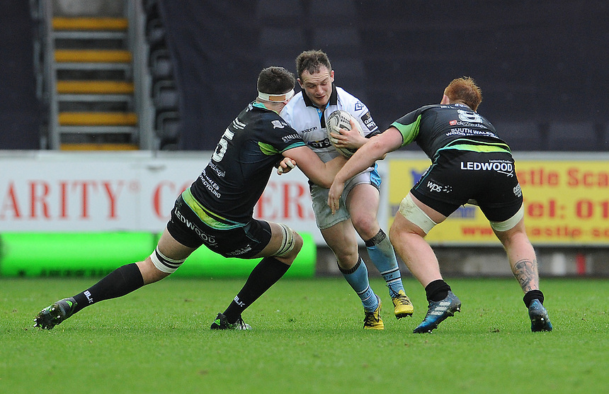 Glasgow Warriors' Nick Grigg is tackled by Ospreys' Rory Thornton<br /> <br /> Photographer Ian Cook/CameraSport<br /> <br /> Guinness PRO12 Round 16  - Ospreys v Glasgow Warriors - Sunday 26th February 2017 - Liberty Stadium - Swansea<br /> <br /> World Copyright &copy; 2017 CameraSport. All rights reserved. 43 Linden Ave. Countesthorpe. Leicester. England. LE8 5PG - Tel: +44 (0) 116 277 4147 - admin@camerasport.com - www.camerasport.com