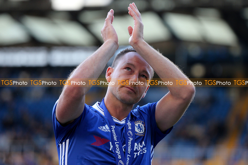 John Terry applauds the home fans for the last time as a Chelsea player during Chelsea vs Sunderland AFC, Premier League Football at Stamford Bridge on 21st May 2017
