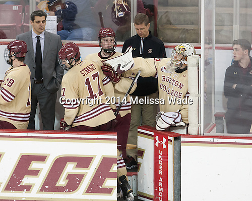 Marty McInnis (BC - Assistant Coach), Destry Straight (BC - 17), Adam Gilmour (BC - 14), Bert Lenz (BC - Director-Sports Medicine), Brad Barone (BC - 29), Stephen Shea (BC - Student Manager) - The Boston College Eagles defeated the visiting University of Michigan Wolverines 5-1 (EN) on Saturday, December 13, 2014, at Kelley Rink in Conte Forum in Chestnut Hill, Massachusetts.