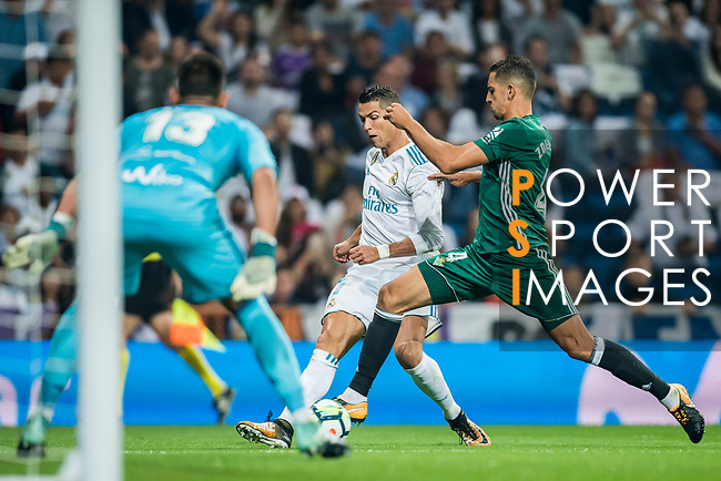 Cristiano Ronaldo (l) of Real Madrid is tackled by Zouhair Feddal Agharbi of Real Betis during the La Liga 2017-18 match between Real Madrid and Real Betis at Estadio Santiago Bernabeu on 20 September 2017 in Madrid, Spain. Photo by Diego Gonzalez / Power Sport Images