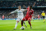 Lucas Vazquez (L) of Real Madrid fights for the ball with David Alaba of FC Bayern Munich during the UEFA Champions League Semi-final 2nd leg match between Real Madrid and Bayern Munich at the Estadio Santiago Bernabeu on May 01 2018 in Madrid, Spain. Photo by Diego Souto / Power Sport Images