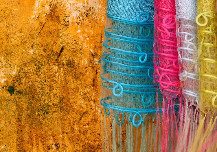 Silk Fabric 05 - Silk scarves against an ochre wall, Hoi An, Viet Nam