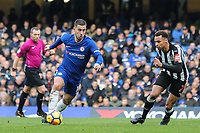 Eden Hazard of Chelsea under pressure from Jacob Murphy of Newcastle United during the Premier League match between Chelsea and Newcastle United at Stamford Bridge, London, England on 2 December 2017. Photo by David Horn.