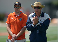 Apr 11, 2015; Los Angeles, CA, USA; Occidental College Tigers coach Robert Bartlett (left) and Pomona-Pitzer Sagehens coach Kirk Reynolds during a SCIAC multi dual meet at Occidental College. Photo by Kirby Lee
