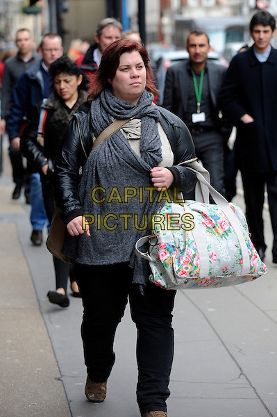 KATY BRAND.Shopping on Great Portland Street, London, England..31st March 2010.*EXCLUSIVE ALL ROUNDER*.full length jeans denim black grey gray scarf jacket white pink blue floral print bag .CAP/IA.©Ian Allis/Capital Pictures.