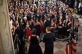 Washington, DC - December 13, 2009 -- United States President Barack Obama and First Lady Michelle Obama address guests in the Grand Foyer of the White House during a holiday party, Sunday, December 13, 2009. .Mandatory Credit: Pete Souza - White House via CNP