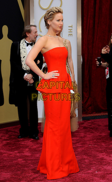 HOLLYWOOD, CA - MARCH 2: Jennifer Lawrence arriving to the 2014 Oscars at the Hollywood and Highland Center in Hollywood, California. March 2, 2014. <br /> CAP/MPI/COR99<br /> &copy;COR99/MediaPunch/Capital Pictures