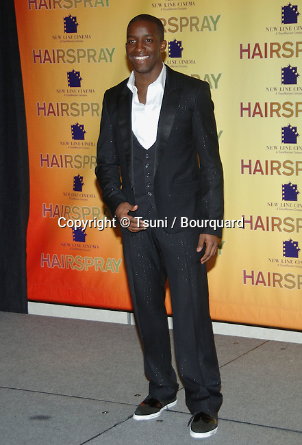 Elijah Kelley  at the HAIRSPRAY Press Call at SHOWEST in Las Vegas.<br /> <br /> eye contact<br /> full lenght<br /> smile