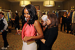 Honoree Tiffany Avery Smith gets an adjustment backstage at the annual Houston Chronicle's Best Dressed Luncheon at the Westin Galleria Hotel Tuesday April 3, 2013.(Dave Rossman photo)