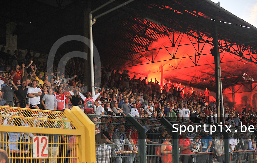 20130903 - ANTWERPEN , BELGIUM : Antwerp supporters pictured with Bengal Fire during the female soccer match between Royal Antwerp FC Vrouwen and SC Heerenveen at the BOSUIL STADIUM , of the second matchday in the BENELEAGUE competition. Tuesday 3 September 2013. PHOTO DAVID CATRY