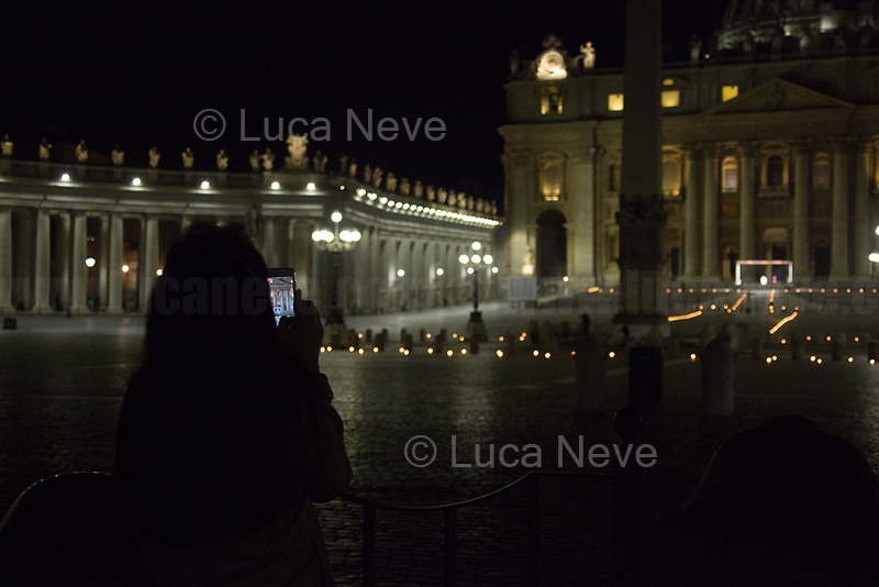 "Rome, 10/04/2020. On the evening of the Good Friday, Papa Francesco (Pope Francis, Jorge Mario Bergoglio) celebrated the Via Crucis (Way to the Cross: the final moments of the Passion, death and burial of Jesus Christ) in a spectral Saint Peter's Square where the path of the Cross was marked with burning torches located around the obelisk. These year, the traditional Via Crucis could not be held at the Colosseum, people were not allowed to attend it, and member of the press were kept really far from the event due to the spread of the Coronavirus (SARS-CoV-2 - infection: COVID-19) which already killed more than 100,000 people globally.      <br /> «[…] For 2020, the meditations for the fourteen ""Stations"" along the Way of the Cross were prepared by the chaplaincy of the Due Palazzi House of Detention in the northern Italian city of Padua. Five prisoners, the family of a murder victim, the daughter of a man given a life sentence, the mother of another prisoner, a guard, and a priest who was convicted of a crime but eventually exonerated, were among those contributing their reflections on the Passion of the Lord, and how it bears on their own situations. […] With the path marked out by burning torches on the ground, the black Cross was carried around the obelisk at the centre of the Square, before coming to the door of the Basilica. The Cross was escorted by members of the Due Palazzi chaplaincy, and by members of the Health and Hygiene Directorate of the Vatican City State. […]» (1.).<br /> <br /> Footnotes & Links:<br /> 1. https://www.vaticannews.va/en/pope/news/2020-04/pope-francis-leads-good-friday-via-crucis-at-st-peter-basilica.html<br /> Video of the event (Source, Vaticannews.va) https://youtu.be/nxUTl7yBt7E"