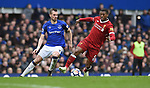 Georginio Wijnaldum of Liverpool is challenged by Morgan Schneiderlin of Everton during the premier league match at Goodison Park Stadium, Liverpool. Picture date 7th April 2018. Picture credit should read: Robin Parker/Sportimage