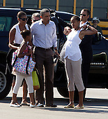 United States President Barack Obama, flanked by his wife Michelle, daughter Sasha, far left, and daughter Malia, right, get ready to board Marine One helicopter on Martha's Vineyard, Massachusetts Sunday, August 29, 2010. The First Family completed their 10-day vacation on Martha's Vineyard and were flying to Cape Cod to board Air Force One  for New Orleans where the President is giving a speech today on the fifth year anniversary of Hurricane Katrina. .Credit: Vincent DeWitt - Pool via CNP