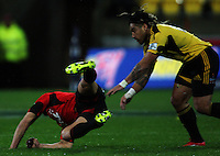 Ma'a Nonu tackles Daniel Carter. Super 15 rugby match - Crusaders v Hurricanes at Westpac Stadium, Wellington, New Zealand on Saturday, 18 June 2011. Photo: Dave Lintott / lintottphoto.co.nz