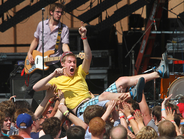 Ian Ray of Cedar Rapids crowd surfs while Titus Andronicus plays to the crowd during the 80/35 Music Festival at Western Gateway Park July 2 in Des Moines.
