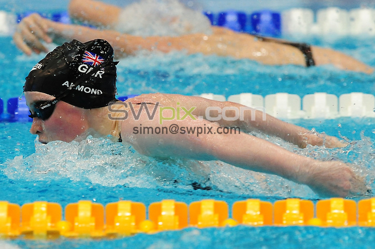 PICTURE BY ALEX BROADWAY/SWPIX.COM...Swimming - 2011 IPC Swimming European Championships - SSE Europasportpark, Berlin, Germany... Day Seven - 09/07/11... Gemma Almond of Great Britain competes in the Women's 100m butterfly S10 final.