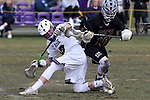 St Rose High Schol takes on Red Bank Regional High School in a boys varsity lacrosse held in Wall Township.<br />  Ryan Harms (left) from St. Rose High School kicks the ball away from a Red Bank Regional defender during game action. (3/28/18)<br /> (MARK R. SULLIVAN /THE COAST STAR)