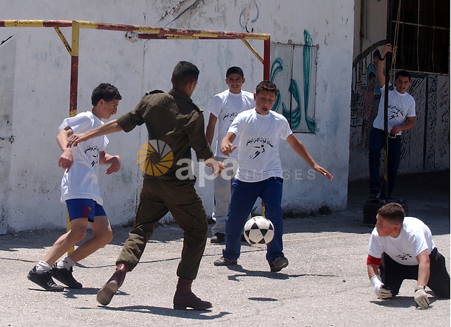 Palestinian security forces display their skills in front of school students in the West Bank city of Nablus on May 13, 2010. Photo by Wagdi Eshtayah