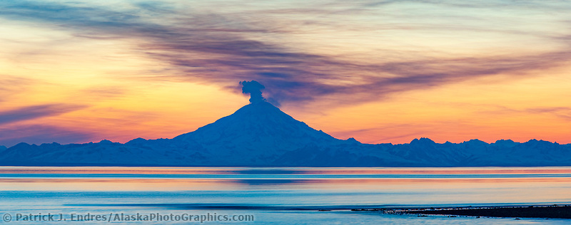 Plume of gas and vapor vent from the summit of Mt. Redoubt volcano (10,191 ft), of the Chigmit mountains, Aleutian range. View across Cook Inlet approximately 50 miles, at sunset, southcentral, Alaska.
