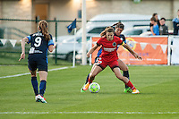 Kansas City, Mo. - Saturday April 23, 2016: FC Kansas City defender Brittany Taylor (13) and Portland Thorns FC midfielder Tobin Heath (17) fight for possession during a match at Swope Soccer Village. The match ended in a 1-1 draw.
